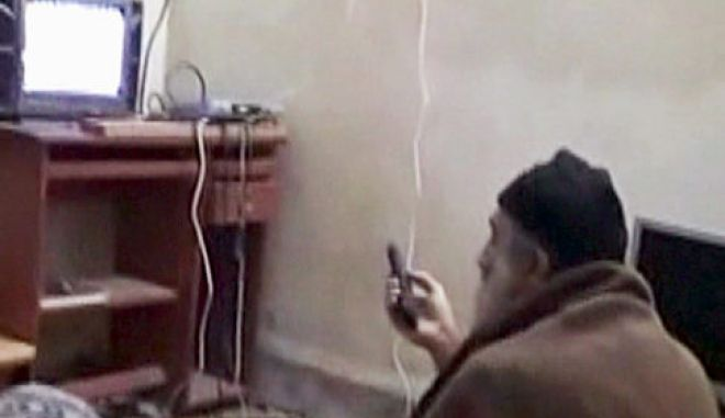 "This framegrab from an undated video released by the US Department of Defense on May 7, 2011, reportedly show Al-Qaeda leader Osama bin Laden watching television at his compound in Abbottabad, Pakistan. According to the Defense Department, the video was seized from the compound during a May 1 operation by US special forces in which bin Laden was killed.    = RESTRICTED TO EDITORIAL USE - MANDATORY CREDIT ""AFP PHOTO / US Department of Defense"" - NO MARKETING NO ADVERTISING CAMPAIGNS - DISTRIBUTED AS A SERVICE TO CLIENTS  = (Photo credit should read -/AFP/Getty Images)   Original Filename: Was3911825.jpg"