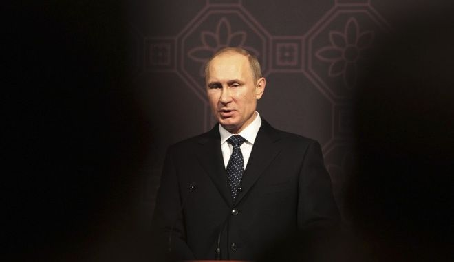 Russian President Vladimir Putin delivers a speech during Korea-Russia Business Dialogue at a hotel in Seoul, South Korea, Wednesday, Nov. 13, 2103. Putin arrived in Seoul on Wednesday for a one-day visit for his second summit talks with South Korean President Park Geun-hye. (AP Photo/Ahn Young-joon)