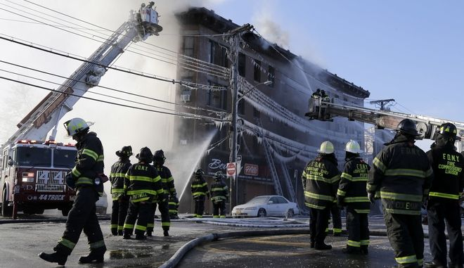 Firefighters work to contain a fire in the Bronx section of New York, Tuesday, Jan. 2, 2018. (AP Photo/Seth Wenig)