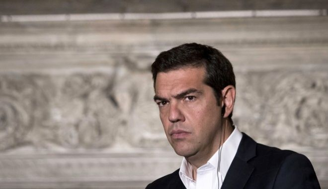 FILE - In this Monday, June 19, 2017 file photo Greek Prime Minister Alexis Tsipras listens during a press conference with his Turkish counterpart Binali Yildirim after their meeting in Athen.  Prime Minister Alexis Tsipras' office says on Friday, July 7, 2017, he has been admitted to an Athens hospital and undergone surgery to remove a hernia. (AP Photo/Petros Giannakouris,File)
