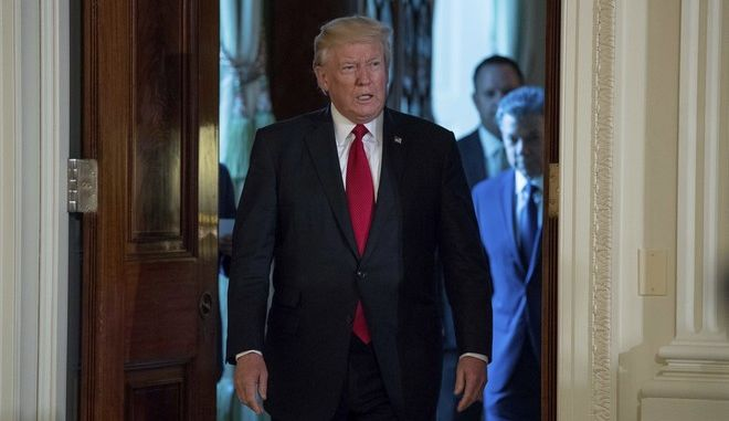 President Donald Trump accompanied by Colombian President Juan Manuel Santos, right, arrives for a news conference in the East Room of the White House, Thursday, May, 18th, 2017, in Washington. (AP Photo/Andrew Harnik)