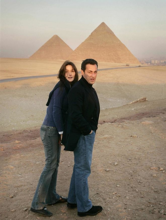 FILE - This Dec. 30, 2007 file photo shows French President Nicolas Sarkozy and his new companion Italian supermodel-turned-singer Carla Bruni, left, looking back at photographers as they admire a view of the Giza Pyramids at sunset in Cairo, Egypt. (AP Photo/Ben Curtis/File)