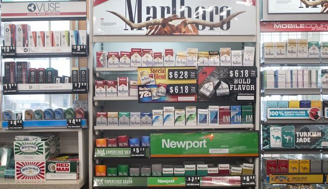 """Packs of cigarettes are offered for sale at a convenience store in Helena, Mont., on Thursday, May 18, 2017. The nation's two largest tobacco companies spent a combined $147,000 through the first three months of the Montana legislative session to kill what would have been the state's first tobacco tax increase in 12 years. That's more than they spent lobbying the Montana Legislature in the past decade. Anti-smoking lobbyists say Montana is targeted because Big Tobacco worried similar taxes would pass elsewhere if the measure passed in a state with cowboys and wide open spaces just like """"Marlboro Country."""" (AP Photo/Bobby Caina Calvan)"""