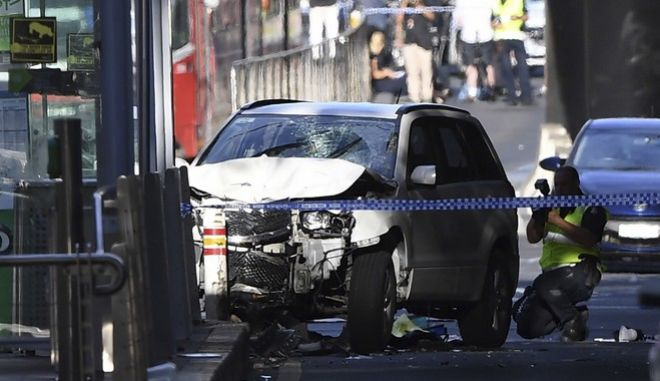 A damaged vehicle is seen at the scene of an incident on Flinders Street, in Melbourne, Thursday, December 21, 2017. Police have arrested a driver after a car drove into pedestrians on a sidewalk in central Melbourne. (Joe Castro/AAP Image via AP)