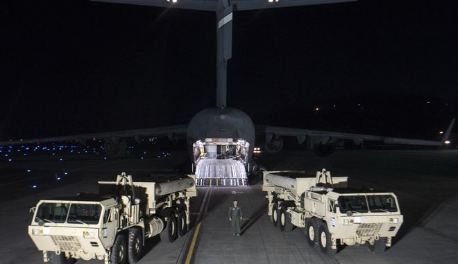FILE - In this March 6, 2017 file photo provided by U.S. Forces Korea, trucks carrying parts of U.S. missile launchers and other equipment needed to set up Terminal High Altitude Area Defense (THAAD) missile defense system arrive at Osan air base in Pyeongtaek, South Korea. Americas top Pacific commander is confident in the ability of a contentious U.S. missile defense system soon to operate in South Korea to shoot down North Korean missiles. (U.S. Force Korea via AP, File)