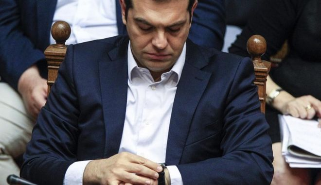 Greece's Prime Minister Alexis Tsipras attends an emergency Parliament session for the governments proposed referendum in Athens on Saturday, June 27, 2015.