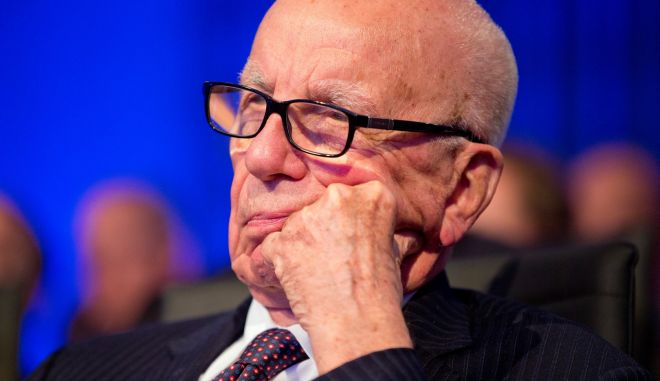 Businessman Rupert Murdoch watches as President Barack Obama speaks at the Wall Street Journal CEO Council annual meeting in Washington, Tuesday, Nov. 19, 2013. Obama answered questions on the economy, the problems with the new health care law roll out, immigration reform, and negotiations with Iran over their nuclear program. (AP Photo/ Evan Vucci)