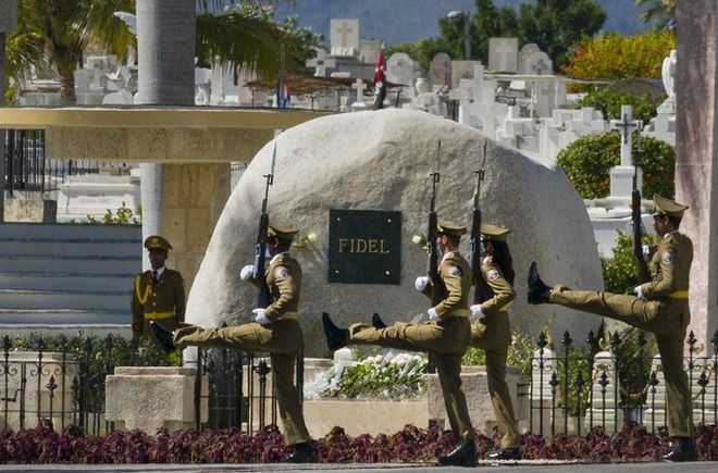 An honor guard marches in front of Fidel Castro's tomb at the Santa Ifigenia cemetery in Santiago, Cuba, Sunday, Dec. 4, 2016. Fidel Castro's ashes were interred in a private ceremony Sunday morning, ending nine days of mourning for the man who ruled Cuba for nearly half a century.(AP Photo/Ramon Espinosa)