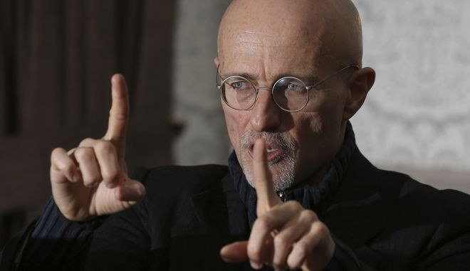 Professor Sergio Canavero gestures as he speaks to the media during a press conference in Glasgow, Scotland, Friday Nov. 18, 2016. (AP Photo/Scott Heppell)