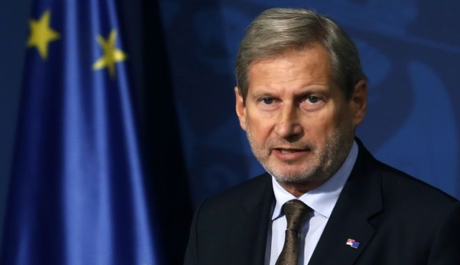 EU Enlargement Commissioner Johannes Hahn speaks during a press conference after talks with Serbia's Prime minister Ana Brnabic, in Belgrade, Serbia, Friday, Sept. 15, 2017. Hahn has urged Serbia and its neighbors to keep on course toward membership of the bloc, amid Russia's attempts to maintain influence in the region. (AP Photo/Darko Vojinovic)
