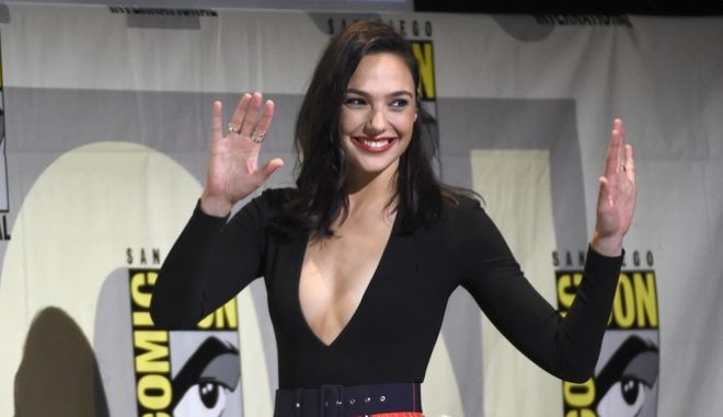 """Gal Gadot walks on stage at the """"Wonder Woman"""" panel on day 3 of Comic-Con International on Saturday, July 23, 2016, in San Diego. (Photo by Chris Pizzello/Invision/AP)"""