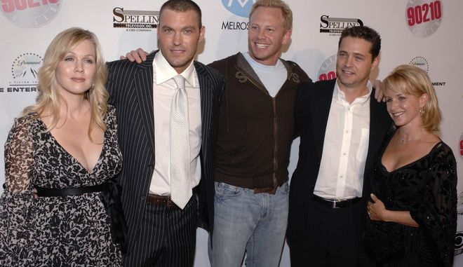 FILE - In this Nov. 3, 2006, file photo, Beverly Hills 90210 cast members, left to right, Jennie Garth, Brian Austin Green, Ian Ziering, Jason Priestley and Gabrielle Carteris attend the Beverly Hills 90210 and Melrose Place first season DVD launch party held at the Beverly Hilton Hotel in Beverly Hills, Calif. Some cast members paid tribute to Doherty Saturday, Nov. 12, 2016, during a cast reunion in Chicago. (AP Photo/Phil McCarten, File)