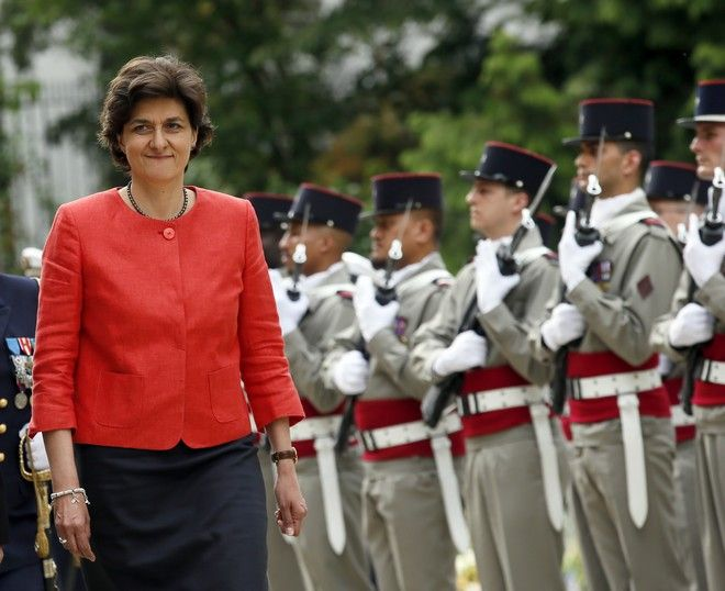 Newly named French defense minister, Sylvie Goulard, 59, right, reviews an honor guard during an handover ceremony with her predecessor, Jean-Yves Le Drian, in Paris, France, Wednesday May, 17, 2017. French President Emmanuel Macron named a mix of prominent and unknown figures from the left and the right Wednesday to make up the government tasked with pushing through his plans to reduce labor protections, tighten European unity and boost military spending. (AP Photo/Francois Mori)