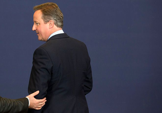 French President Francois Hollande, left, puts his hand on the arm of British Prime Minister David Cameron at the start of a group photo at an EU summit in Brussels on Tuesday, June 28, 2016. EU heads of state and government meet Tuesday and Wednesday in Brussels for the first time since Britain voted to leave the European Union, throwing British and European politics into disarray. (AP Photo/Geoffroy Van der Hasselt)