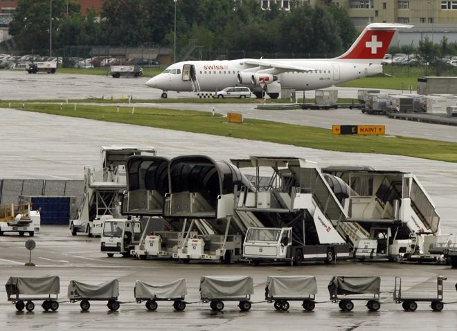 Partial view of Zurich airport during a one-day strike of pilots working for Swiss International Air Lines, Tuesday, Sept. 26, 2006, at the Zurich airport in Kloten, Switzerland. The strike has led to the cancellation of more than 40 European flights. The move affects short-haul Avro airliners. Switzerland's national carrier said it expected flight delays and cancellations throughout the day. Zurich airport is most affected by the strike.  (AP Photo/Keystone, Steffen Schmidt)