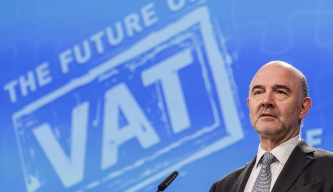European Commissioner for Economic and Financial Affairs Pierre Moscovici addresses the media on the future of VAT at EU headquarters in Brussels on Thursday, Jan. 18, 2018. Today, the European Commission proposed new rules to give Member States more flexibility to set Value Added Tax (VAT) rates and to create a better tax environment to help SME's flourish. (AP Photo/Geert Vanden Wijngaert)