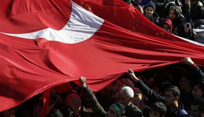 Protesters, holding a huge Turkish flags march in the streets after Friday prayers in Istanbul, Friday, Dec. 8, 2017, against U S. President Donald Trump's decision to recognise Jerusalem at the capital of Israel. More than 3,000 people gathered outside a mosque in Istanbul's conservative Fatih district and were marching toward a park, waving Palestinian flags and chanting slogans protesting the United States and Israel. (AP Photo/Lefteris Pitarakis)