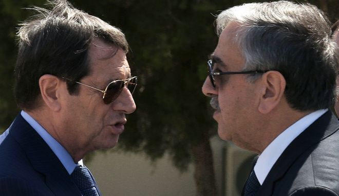 Cypriot President Nicos Anastasiades, left, breakaway Turkish Cypriot leader Mustafa Akinci, right, talks as the UN Special Advisor of the Secretary-General Espen Barth Eide, right, looks on as they leave their talks aimed at reunifying the ethnically divided island, at the disused Nicosia airport inside a United Nations controlled buffer zone on Wednesday, Sept. 14, 2016. The rival leaders of ethnically split Cyprus say they will meet with the U.N. Chief later this month to take stock of ongoing reunification talks and ask him to step up his personal involvement in the months ahead. (AP Photo/Petros Karadjias)