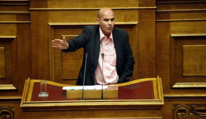 Συζήτηση στην Ολομέλεια της Βουλής το νομοσχέδιο του Υπ. Οικονομικών για περιστολή δημοσίων Δαπανών (για μισθό Κ. Παπούλια, πρωθυπουργού, υπουργών, κτλ) την Τρίτη 18 Σεπτεμβρίου 2012. (EUROKINISSI/ΓΙΩΡΓΟΣ ΚΟΝΤΑΡΙΝΗΣ)