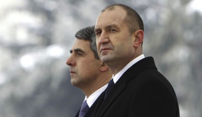 """Newly elected Bulgarian President Rumen Radev, front, stands next to outgoing Bulgarian President Plevneliev, during his inauguration ceremony in Sofia, Bulgaria, Sunday, Jan. 22, 2017. Rumen Radev has assumed office as Bulgaria's new president after an inauguration ceremony in front of the landmark Alexander Nevski cathedral in Sofia. In his first speech as president, Radev underscored the idea of continuity and pledged to work for a """"united society in the name of democracy."""" (Oleg Popov/Pool Photo via AP)"""