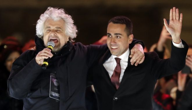 Five-Star Movement (M5S) candidate premier, Luigi Di Maio, right, and party founder Beppe Grillo attend their party's final rally in Rome, Friday, March 2, 2018. General elections in Italy will be held Sunday. (AP Photo/Andrew Medichini)