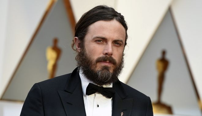 FILE - In this Feb. 26, 2017 file photo, Casey Affleck arrives at the Oscars in Los Angeles. Two women who worked on Casey Afflecks film Im Still Here filed sexual harassment lawsuits against him in 2010. Both claims were settled out of court for an undisclosed amount in 2010. Affleck has repeatedly denied the allegations. He went on to win the best actor Oscar for Manchester by the Sea. (Photo by Jordan Strauss/Invision/AP, File)