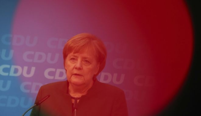 German Chancellor Angela Merkel speaks behind the red light of a TV camera during a press conference after a board meeting of her Christian Democratic Party CDU  in Berlin, Germany, Monday, Nov. 27, 2017. (Michael Kappeler/dpa via AP)
