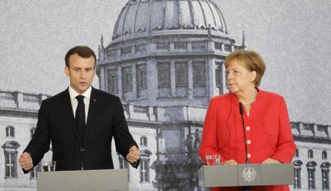 Άγκελα Μέρκελ και Εμανουέλ Μακρόν, μετά από συνάντησή του στο Βερολίνο, Απρίλιος 2018