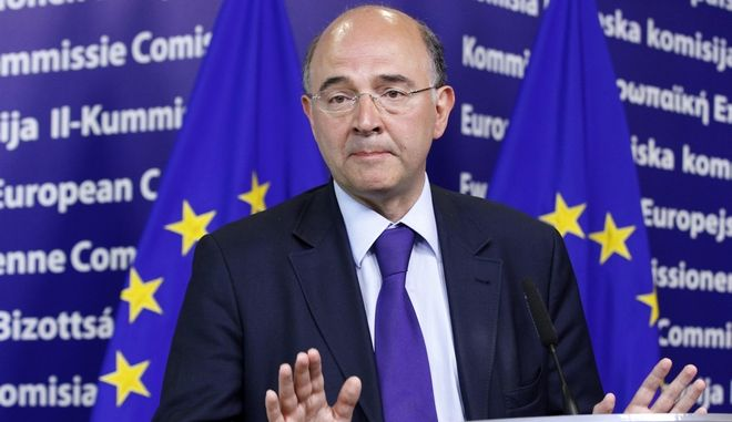 France's Minister of Economy Pierre Moscovici holds a news conference after meeting European Economic and Monetary Affairs Commissioner Olli Rehn (not pictured) at the Commission's Headquarters in Brussels June 4, 2012.  REUTERS/Sebastien Pirlet  (BELGIUM - Tags: POLITICS BUSINESS)