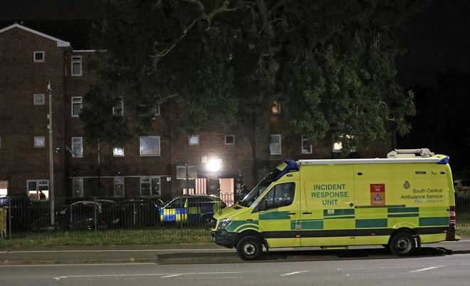 Emergency services is seen near a block of flats off Basingstoke Road in Reading after an incident at Forbury Gardens park in the town centre of Reading, England, Saturday, June 20, 2020. Several people were injured in a stabbing attack in the park on Saturday, and British media said police were treating it as terrorism-related. (Steve Parsons/PA via AP)