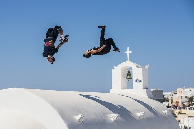 Who will flip, jump, spin and drop their way to the Red Bull Art of Motion final this weekend? Here's a taste of what's in store against the majestic backdrop of the white-washed clifftop houses of Oia on Santorini. Dimitris Kyrsanidis of Greece and Calen Chan of the United States perform during the preshoot for the Red Bull Art Of Motion on Santorini island, Greece on October 5, 2017 // Samo Vidic/Red Bull Content Pool via AP Images  // For more content, pictures and videos like this please go to http://www.redbullcontentpool.com