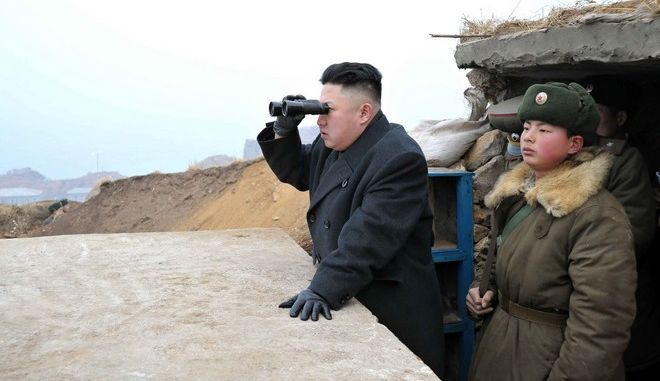 North Korean leader Kim Jong-Un (C) uses a pair of binoculars to look towards the South during his visit to the Jangjae Islet Defence Detachment and Mu Islet Hero Defence Detachment on the front, near the border with South Korea, southwest of Pyongyang March 7, 2013 in this picture released by the North's official KCNA news agency in Pyongyang March 8, 2013. REUTERS/KCNA (NORTH KOREA - Tags: MILITARY POLITICS TPX IMAGES OF THE DAY)  ATTENTION EDITORS - THIS PICTURE WAS PROVIDED BY A THIRD PARTY. REUTERS IS UNABLE TO INDEPENDENTLY VERIFY THE AUTHENTICITY, CONTENT, LOCATION OR DATE OF THIS IMAGE. THIS PICTURE IS DISTRIBUTED EXACTLY AS RECEIVED BY REUTERS, AS A SERVICE TO CLIENTS. QUALITY FROM SOURCE. NO THIRD PARTY SALES. NOT FOR USE BY REUTERS THIRD PARTY DISTRIBUTORS - RTR3EQ0B