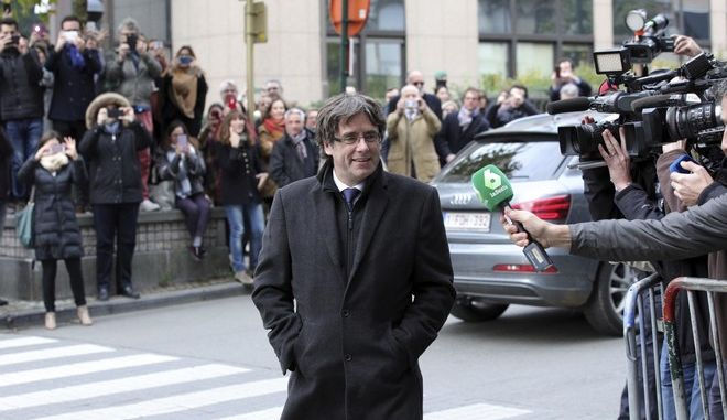Sacked Catalonian President Carles Puigdemont arrives for a press conference in Brussels, Tuesday, Oct. 31, 2017. Puigdemont arrived in Brussels on Monday, the same day that Spanish prosecutors announced they were seeking rebellion, sedition and embezzlement charges against deposed Catalan officials, including the ex-regional leader. (AP Photo/Olivier Matthys)