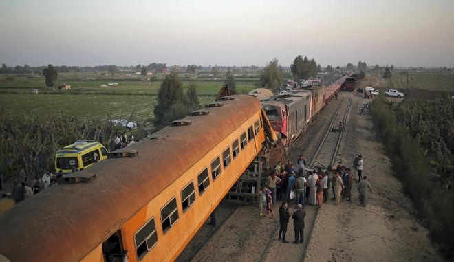 Emergency personnel gather at the scene of a train collision near Kom Hamadah, in the Beheira province in the Nile delta, Egypt, Wednesday, Feb. 28, 2018. Egyptian authorities said two trains collided north of Cairo, killing at least 12 people, including a child, the latest deadly accident involving the countrys underfunded and mismanaged railways. Another 39 people were injured in the accident, according to the countrys state MENA news agency. (AP Photo/Mostafa Darwish)