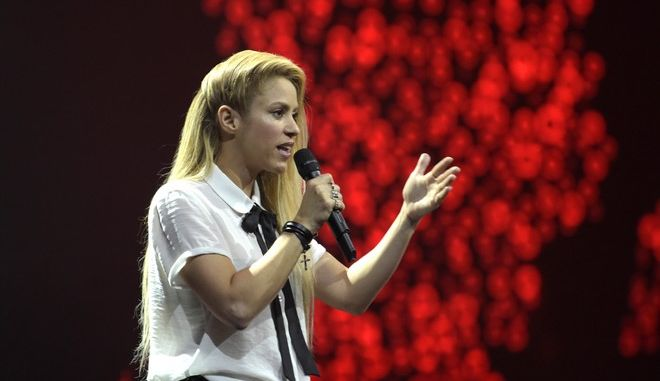 Singer Shakira speaks to the crowd during the Global Citizen Festival concert on the eve of the G-20 summit in Hamburg, northern Germany, Thursday, July 6, 2017. The leaders of the group of 20 meet July 7 and 8. (AP Photo/Jens Meyer)