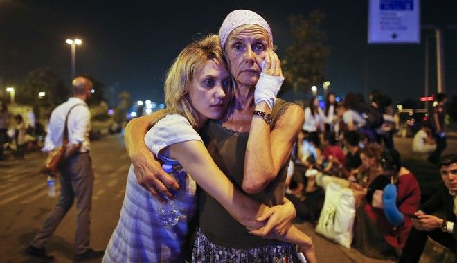 2016 AP YEAR END PHOTOS - Passengers embrace each other as they wait outside Istanbul's Ataturk airport, on June 29, 2016, following their evacuation after a blast. Suspected Islamic State group extremists hit the international terminal of Istanbul's Ataturk airport, killing dozens of people and wounding many others. (AP Photo/Emrah Gurel, File)