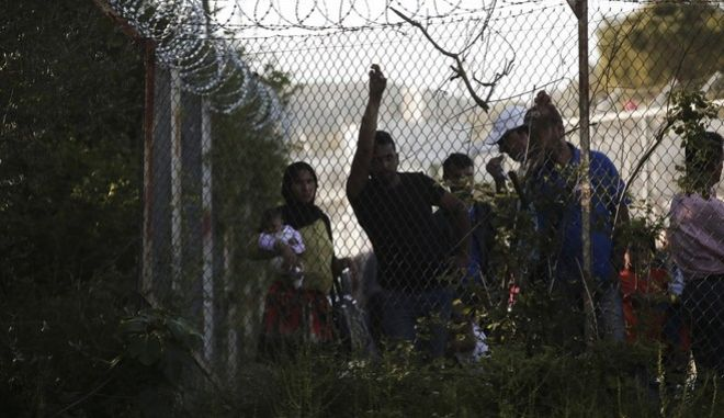 Protest at Moria Refugee Camp organized by All Workers Militant Front (PAME), in Lesvos Island, on Apr. 15, 2016 /         ,  ,  15 , 2016