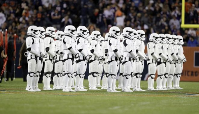 """Stormtroopers line up on the field during halftime of an NFL football game between the Chicago Bears and the Minnesota Vikings, Monday, Oct. 9, 2017, in Chicago. The trailer for """"Star Wars: The Last Jedi"""" debuted in dramatic fashion during Monday Night Football halftime. Fireworks flashed and Stormtroopers marched onto Chicago's Soldier Field as the preview played onscreen. (AP Photo/Darron Cummings)"""