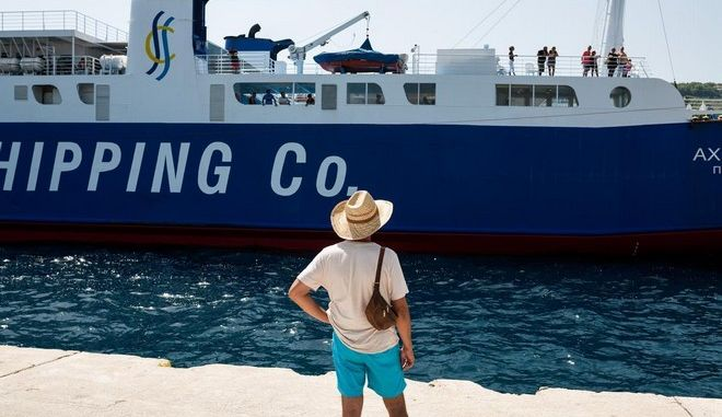 A man looks at a ship which going to depart to Skyros island at the Alonnisos port in Greece on August 21, 2014. /     ,                  21 , 2014