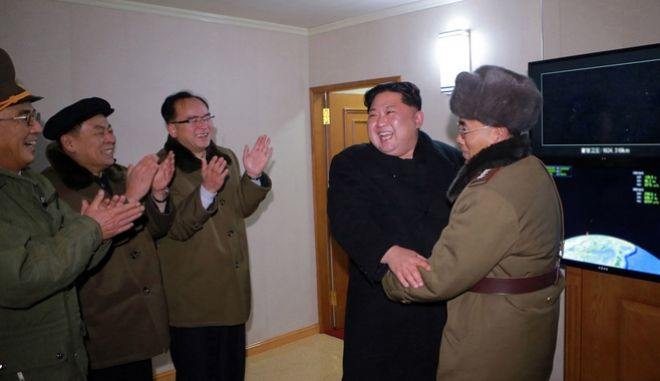 "In this photo provided on Thursday, Nov. 30, 2017, by the North Korean government, North Korean leader Kim Jong Un inspects an intercontinental ballistic missile test in North Korea on Wednesday, Nov. 29. Independent journalists were not given access to cover the event depicted in this image distributed by the North Korean government. The content of this image is as provided and cannot be independently verified. Korean language watermark on image as provided by source reads: ""KCNA"" which is the abbreviation for Korean Central News Agency. (Korean Central News Agency/Korea News Service via AP)"