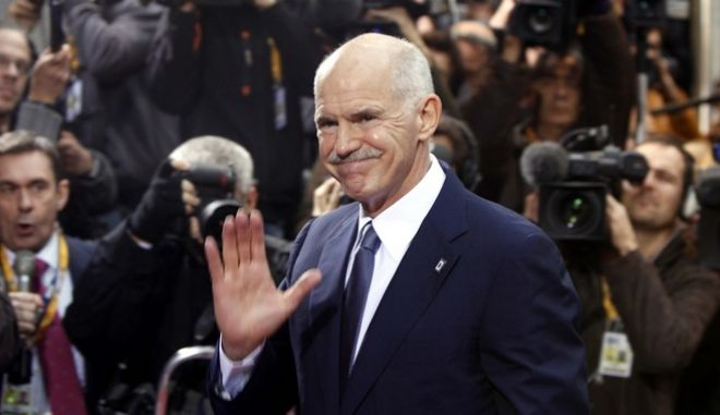 Greek Prime Minister George Papandreou arrives for an EU summit in Brussels on Wednesday, Oct. 26, 2011. A grand plan to resolve Europe's escalating debt crisis was once again in doubt after officials said key parts of the package may not be ready in time for a leaders' summit on Wednesday. (AP Photo/Virginia Mayo)