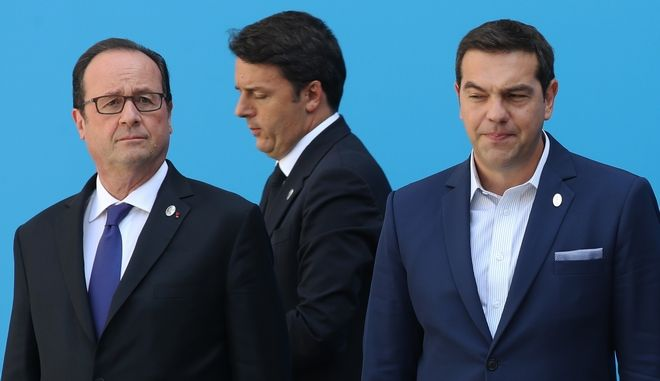 France's President Francois Hollande, left, and Greece's Prime Minister Alexis Tsipras stand as Italy's Prime Minister Matteo Renzi, arrives for a group photo during a Mediterranean Leader's Summit in Athens, Friday, Sept. 9, 2016. Tsipras hosted leaders of Europe's Mediterranean countries Friday as his government rejected a return to European Union immigration rules that existed before last year's crisis. (AP Photo/Petros Giannakouris)