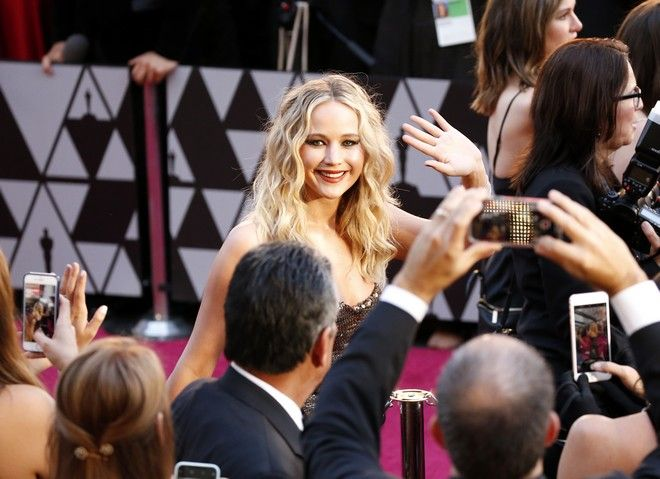 Jennifer Lawrence arrives at the Oscars on Sunday, March 4, 2018, at the Dolby Theatre in Los Angeles. (Photo by Eric Jamison/Invision/AP)