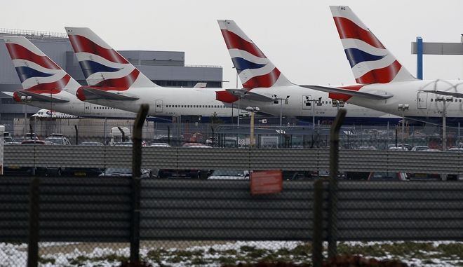 Planes are seen at Heathrow Airport in London, Thursday, Dec. 23, 2010. Normal operation has resumed at airports around Britain after days of disruption due to snow and freezing conditions. (AP Photo/Kirsty Wigglesworth)