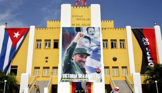 An image of Cuba's Revolution leader Fidel Castro overlooks the former Moncada barracks. The July 26, 1953 attack on the Moncada Garrison signalled the beginning of the Cuban Revolution.