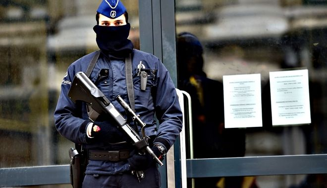 "An armed policeman stands guard at the e...An armed policeman stands guard at the entrance of Belgium's federal prosecutor office in Brussels, January 16, 2015.  Belgian police arrested 13 people during a dozen raids overnight, smashing plot to kill police officers ""in public roads and in police stations"", prosecutors said. AFP PHOTO/Emmanuel DunandEMMANUEL DUNAND/AFP/Getty Images"