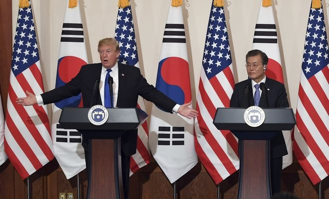 U.S. President Donald Trump, left, speaks as South Korean President Moon Jae-In listens during a joint press conference at the presidential Blue House in Seoul, South Korea, Tuesday, Nov. 7, 2017. (Jung Yeon-Je/Pool Photo via AP)