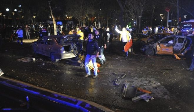 Members of emergency services work at the scene of an explosion in Ankara, Turkey, Sunday, March 13, 2016. A television channel said the bomb exploded close to bus stops near a park at Ankara's main square, Kizilay. The news channel said the explosion occurred as a car slammed into a bus, suggesting that the blast may have been caused by a car bomb. Several vehicles had caught fire, it said. (AP Photo)