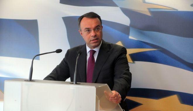 Ο αναπληρωτής υπουργός Οικονομικών, Χρήστος Σταϊκούρας,παρουσιάζει  τα αποτελέσματα 12μήνου του κρατικού προϋπολογισμού  την Τρίτη 14 Ιανουαρίου 2014. (EUROKINISSI/ΚΩΣΤΑΣ ΚΑΤΩΜΕΡΗΣ)