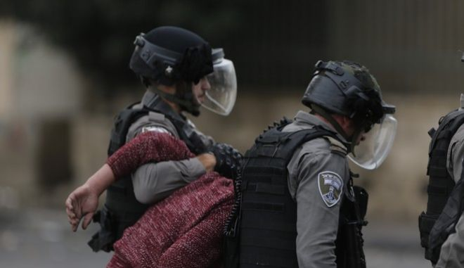Israeli border police arrest a Palestinian protester during clashes following protests against U.S. President Donald Trump's decision to recognize Jerusalem as the capital of Israel, in the West Bank city of Bethlehem, Friday, Dec. 22, 2017.(AP Photo/Nasser Shiyoukhi)